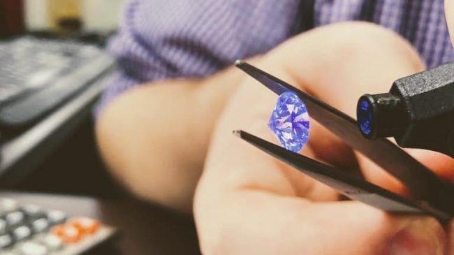 Bluestone Trading Diamond Expert Cody Grampp examining a diamond