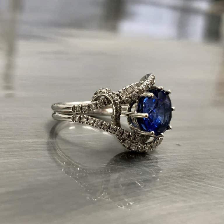 Sapphire Ring with a diamond swirl setting