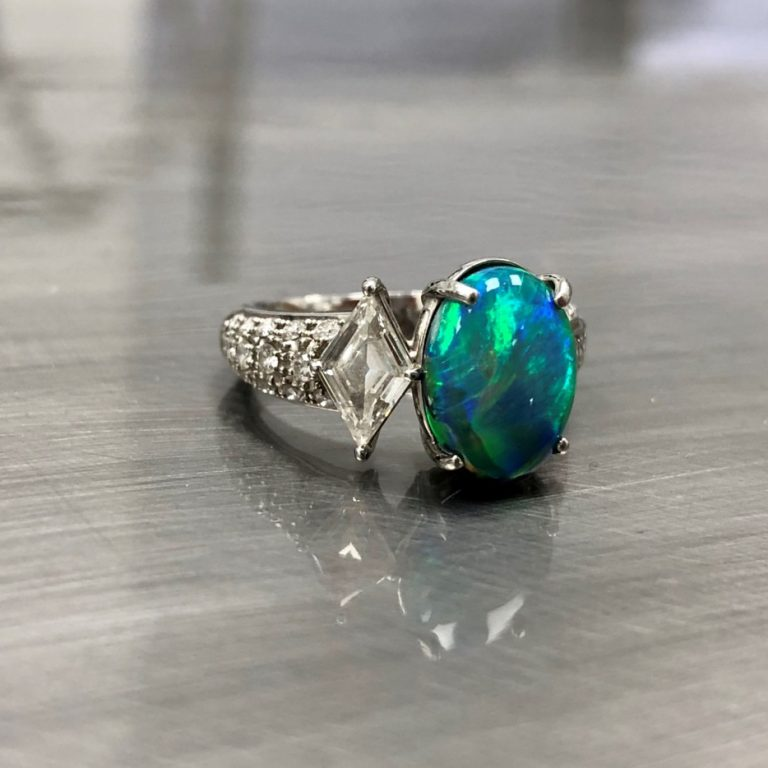 Estate Jewelry Diamond and Gemstone ring on grey background