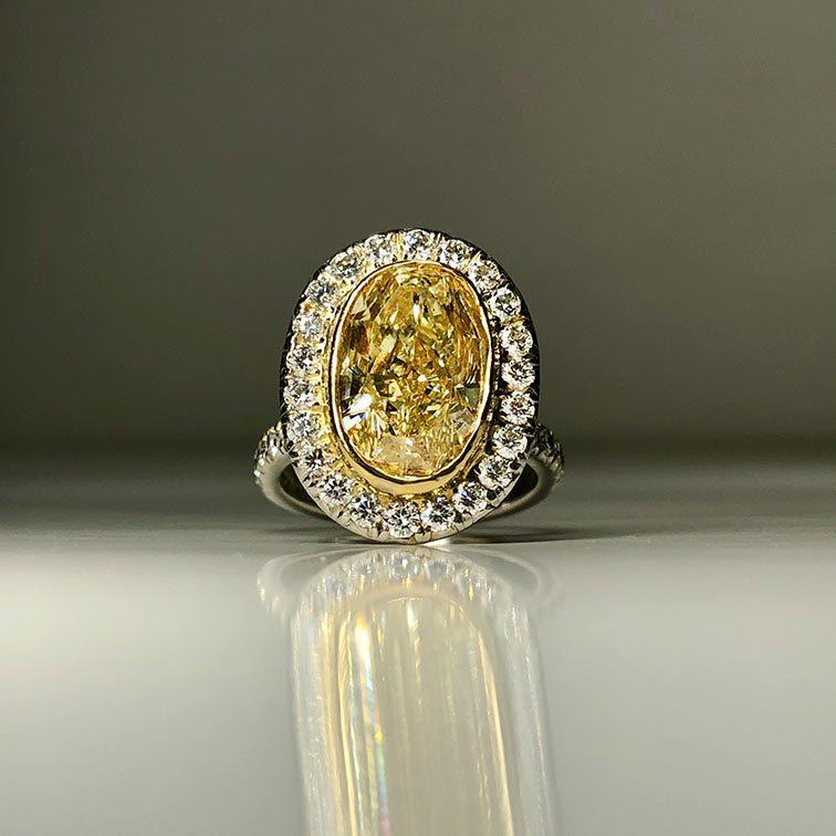 18 Karat Yellow Fancy Yellow Oval Diamond Ring