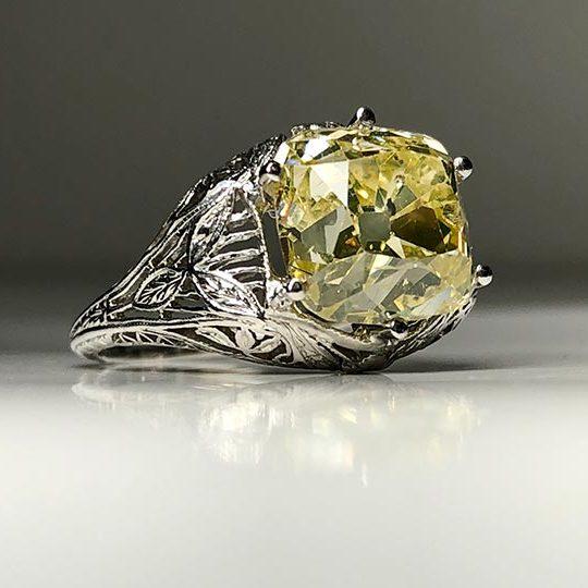 6.35 Fancy Yellow GIA set in a platinum filigree mount
