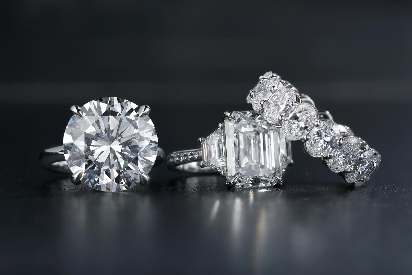 Diamond Jewelry stacked against a black background