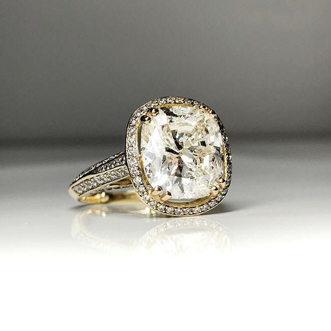 5.84 carat cushion cut I I1 diamond ring (based on in-house grading) set in custom 18KY diamond halo mount