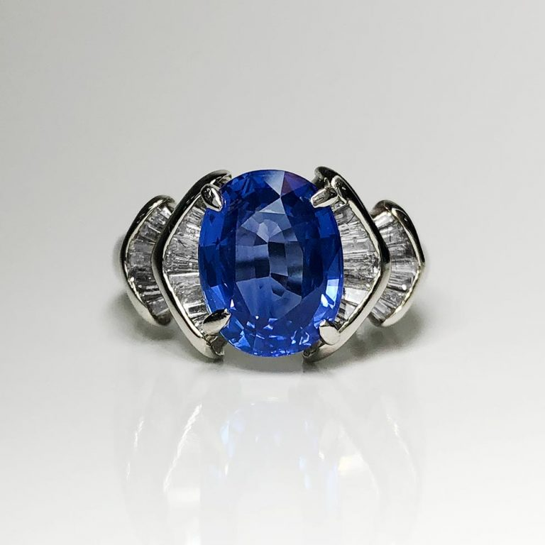 3.9 Carat sapphire center stone, .5 ctw diamond side stones. Platinum setting