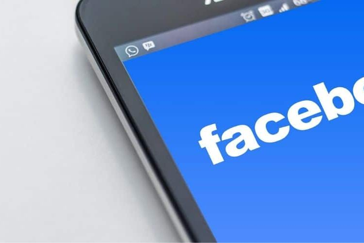 Facebook logo on a phone screen