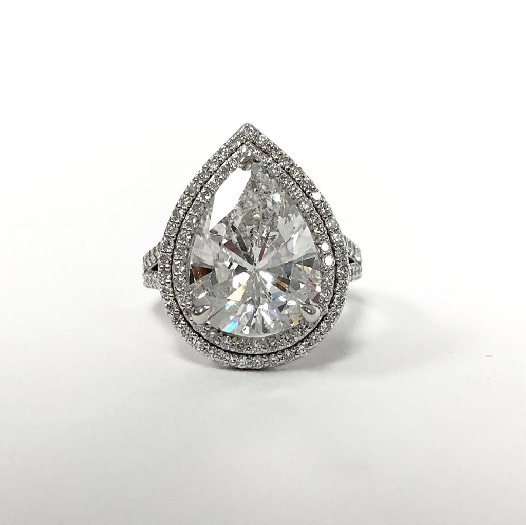 custom pear-shape diamond ring made with a recycled diamond