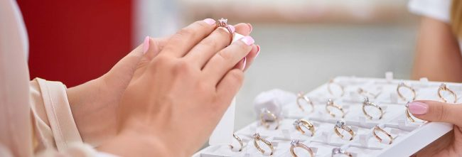 woman trying on diamond rings